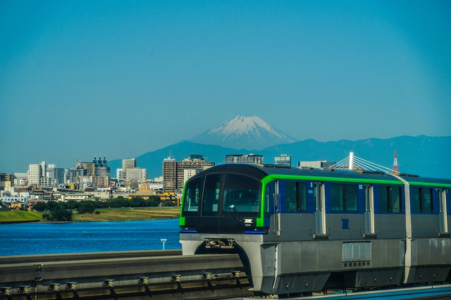 Tokyo Monorail type 10000 train running with Mt. Fuji in the background